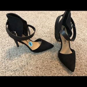 Black heel with strap detail